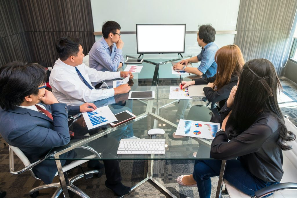 Group of asian Business team having video conference with monitor display in the modern conference